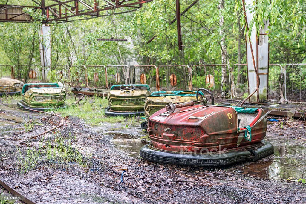obsolete cars playground in Pripyat park stock photo