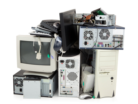 Obsolete computer electronics equipment for recycling, isolated on white.