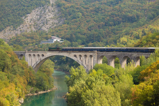 Obsolete diesel train crosing Soca River on Solkan Stone Bridge stock photo