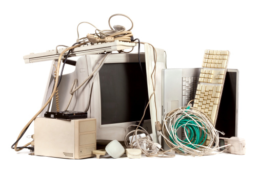 Pile of used, obsolete electronics. E-waste is becoming a major problem worldwide.