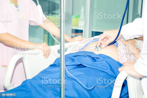 Obstetrician doctor examining pregnant woman with stethoscope and to picture id951666812?b=1&k=6&m=951666812&s=612x612&h=bzrz4wv8 ydknhiqdmhpnbgat5ejm3dvtgy9mcarufs=