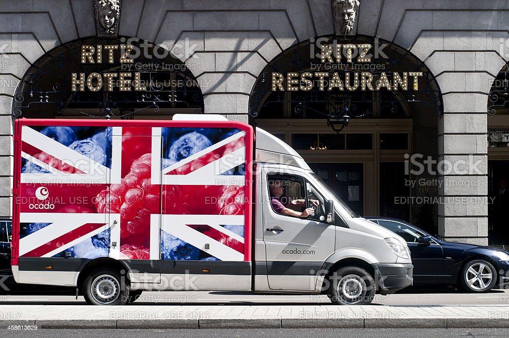 Ocado Delivery Van Passing By The Ritz Hotel stock photo