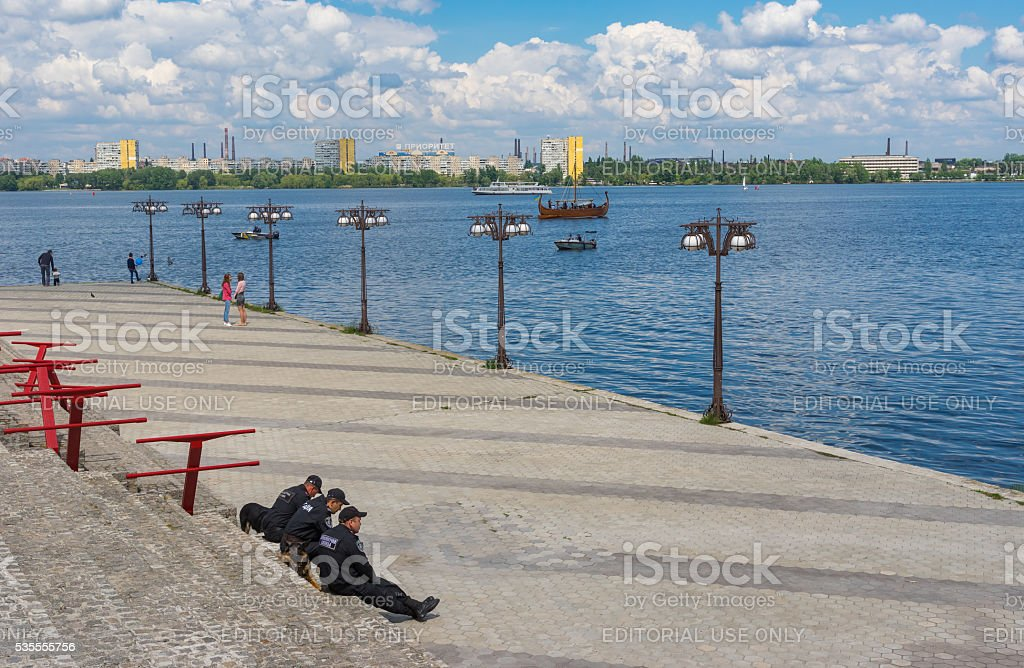 Occasional people on the river Dnepr embankment stock photo