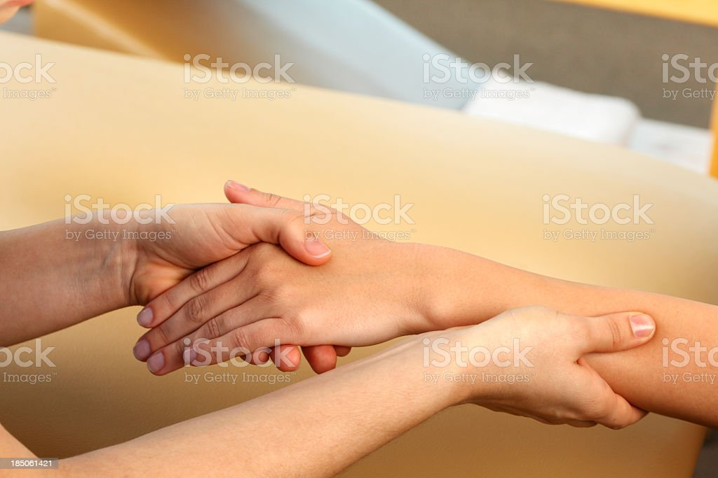 Occupational Therapist Massaging A Woman's Hand royalty-free stock photo