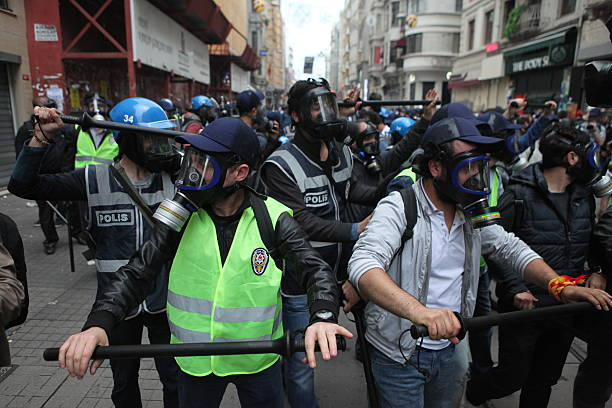 Occupy Gezi Istanbul,Turkey-May 31, 2014: Police use tear gas and water cannons on the tense one year anniversary of the Gezi park protests which sparked wider unrest throughout Turkey on May 31,2014 in Istanbul,Turkey arrestment stock pictures, royalty-free photos & images