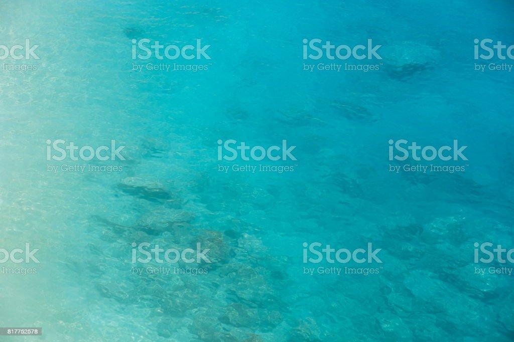 Ocean aerial view turquoise blue sea water gradient stock photo