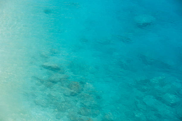 ocean aerial view turquoise blue sea water gradient - rocky coastline stock pictures, royalty-free photos & images