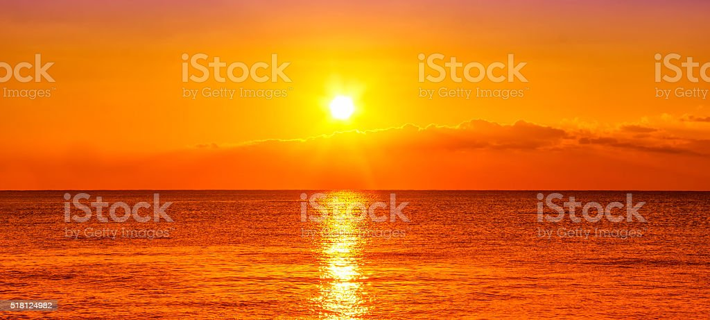 Ocean and sunset stock photo