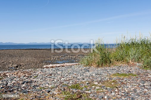 A beach on Hornby Island in British Columbia. You can see the mountains of Vancouver Island from this viewpoint.