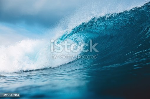 Ocean blue wave in ocean. Breaking wave for surfing in Bali