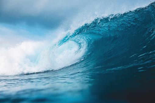 Ocean blue wave in ocean. Breaking wave for surfing in Bali