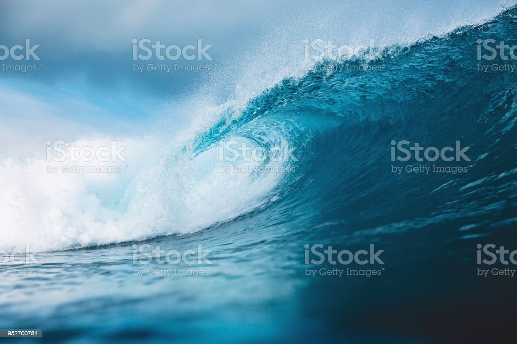 Ocean blue wave in ocean. Breaking wave for surfing in Bali stock photo