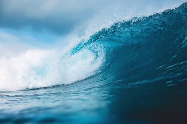ocean blue wave in ocean. breaking wave for surfing in bali - wave stock photos and pictures