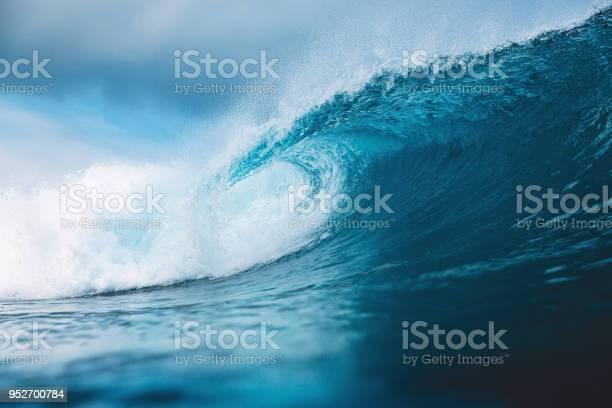 Photo of Ocean blue wave in ocean. Breaking wave for surfing in Bali