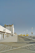 The boardwalk in ocean city, maryland on a bright autumn day with no tourist in sight, and the stores are all closed for the season