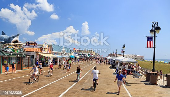 Ocean City, New Jersey - August 05, 2018:  People walking and biking along the boardwalk in Ocean City, New Jersey, USA