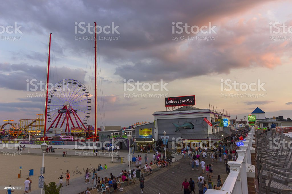 Ocean city, MD boardwalk and pier at sunset 2015 stock photo