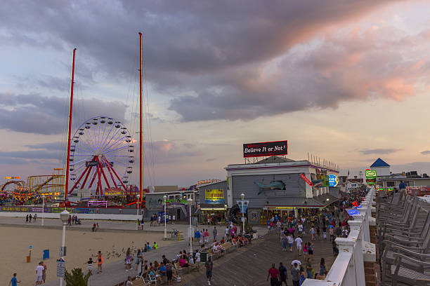Ocean city, MD boardwalk and pier at sunset 2015 Ocean city, Maryland boardwalk and pier at a beautiful sunset in August 2015 boardwalk stock pictures, royalty-free photos & images