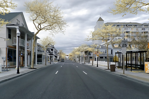South Baltimore street in Ocean City, maryland on an overcast spring morning shot using an IR camera that renders images with a bit of a retro appearance and softens the architecture