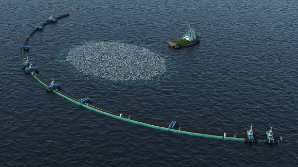 Ocean Cleaning System 3d render of an ocean cleaning system with garbage on the water environmental cleanup stock pictures, royalty-free photos & images