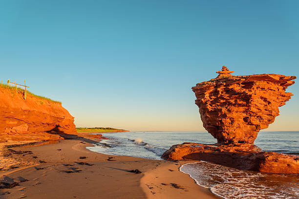 ocean coast at the sunrise - prince edward island stock photos and pictures