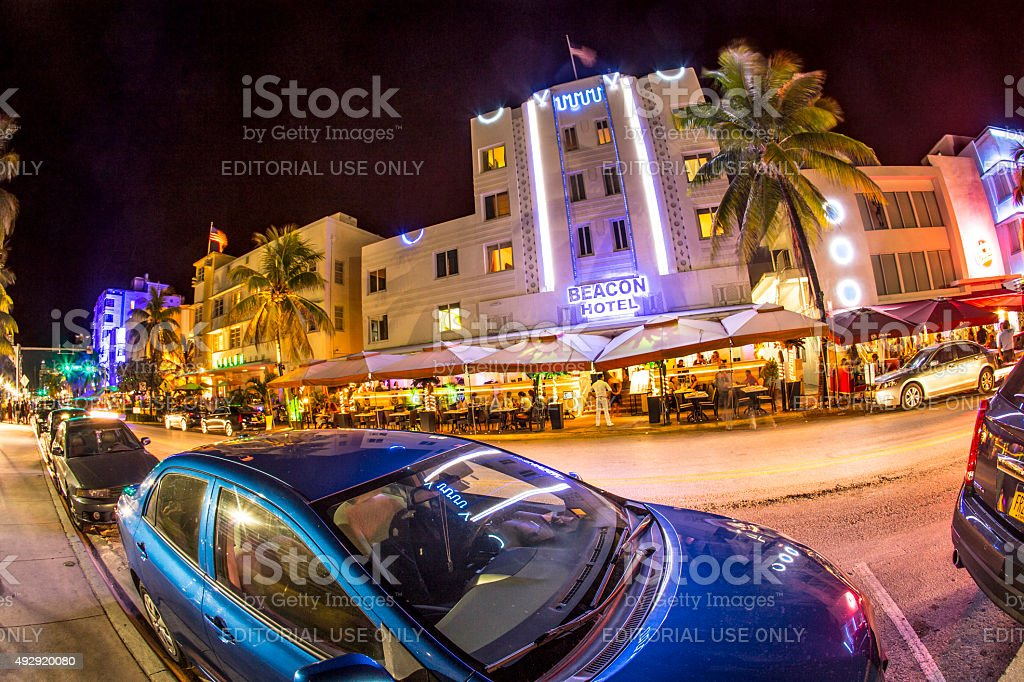 Ocean drive buildings in Art deco style by night stock photo
