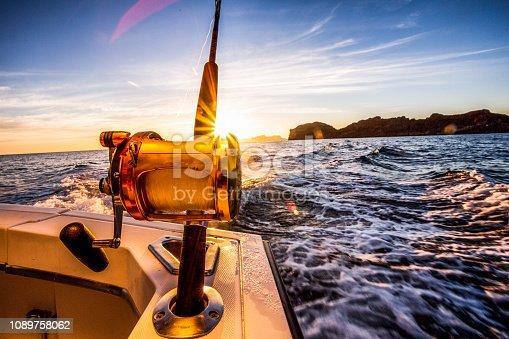 1094918172istockphoto Ocean Fishing Reels Dawn or Dusk 1089758062