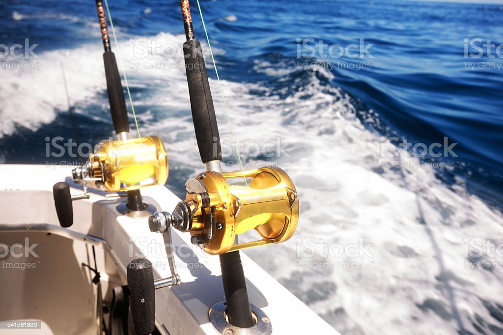 Ocean Fishing Reels On A Boat In The Ocean Stock Photo & More