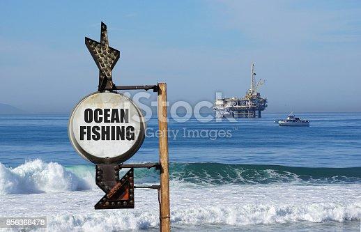 ocean fishing sign with oil platform in ocean