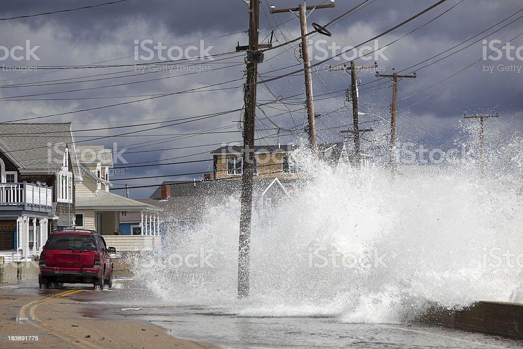 Ocean Flooding Red Car stock photo