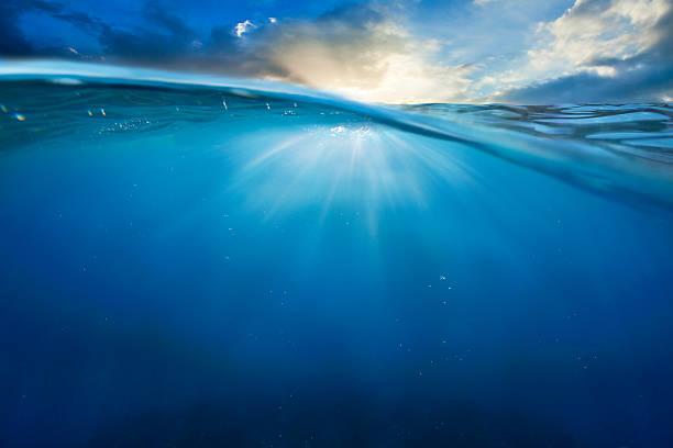 ocean half water with sunset sky stock photo