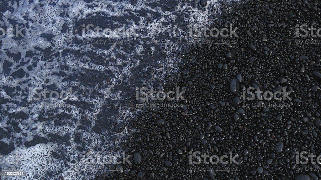 Ocean on a black sand beach stock photo