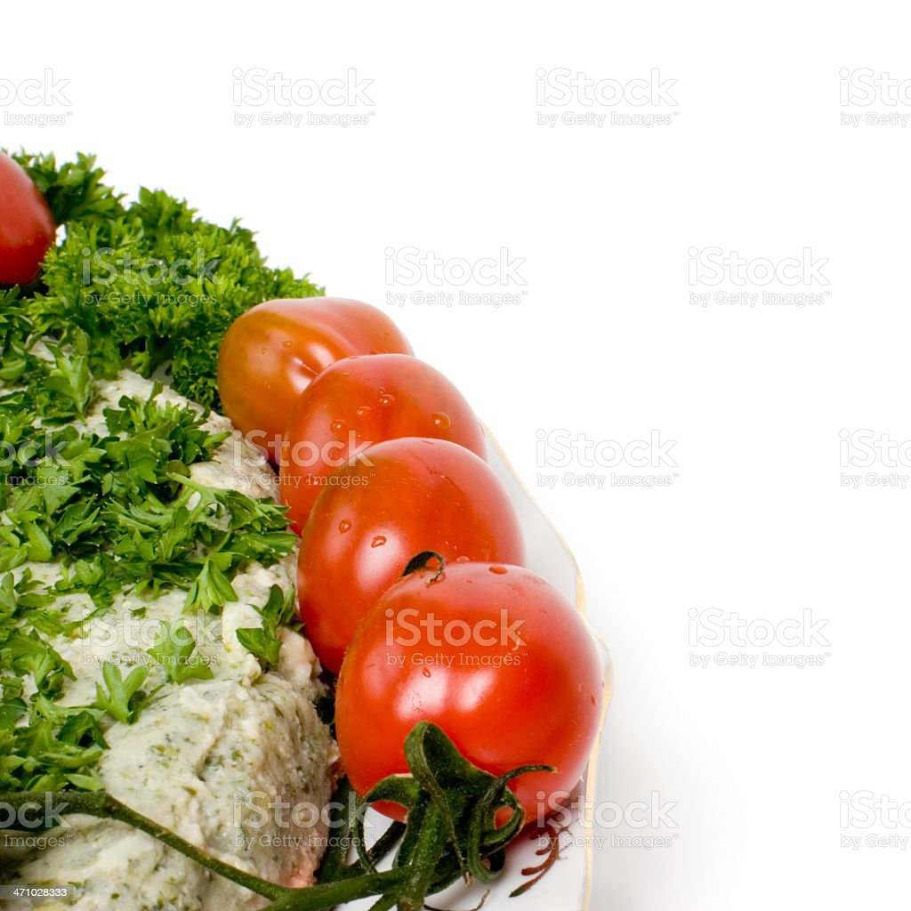 Ocean perch salad fragment with tomatos Dish with salad made of Ocean perch fish. Garnished with parsley and tomatoes. Isolated on white. Caviar Stock Photo