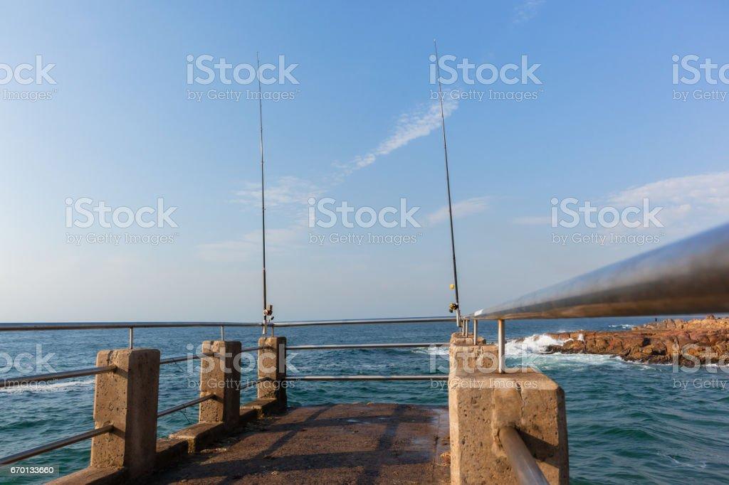 Ocean Pier Fishing Rods stock photo