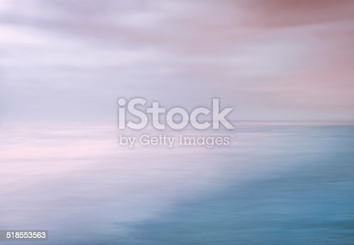 A seascape abstract made with panning motion combined with long exposure.  Image displays soft contrast with split-tone colors.