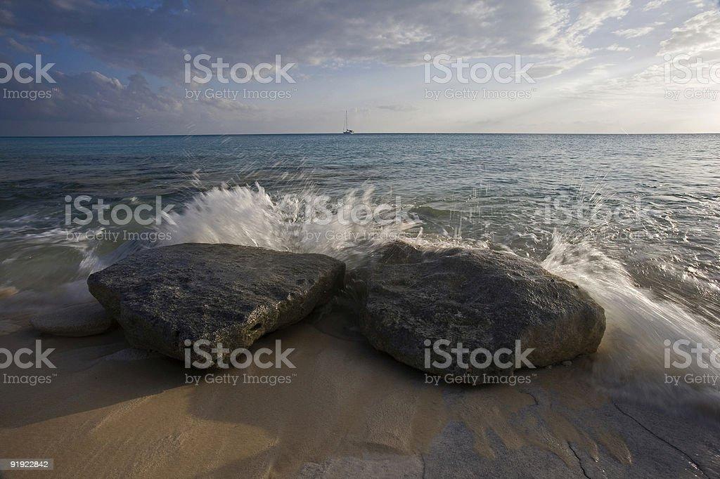 Ocean splash against rocks on the beach stock photo