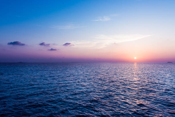 ocean sunset. - ocean stock pictures, royalty-free photos & images