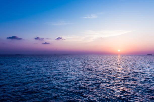 ocean sunset. - ocean imagens e fotografias de stock