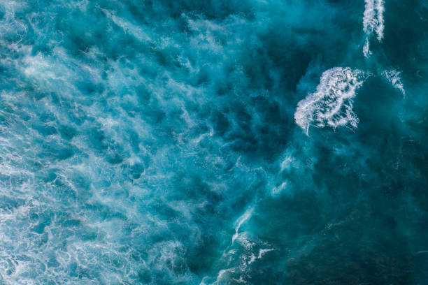 Ocean surf from above Water surface background. Aerial drone shot ocean stock pictures, royalty-free photos & images