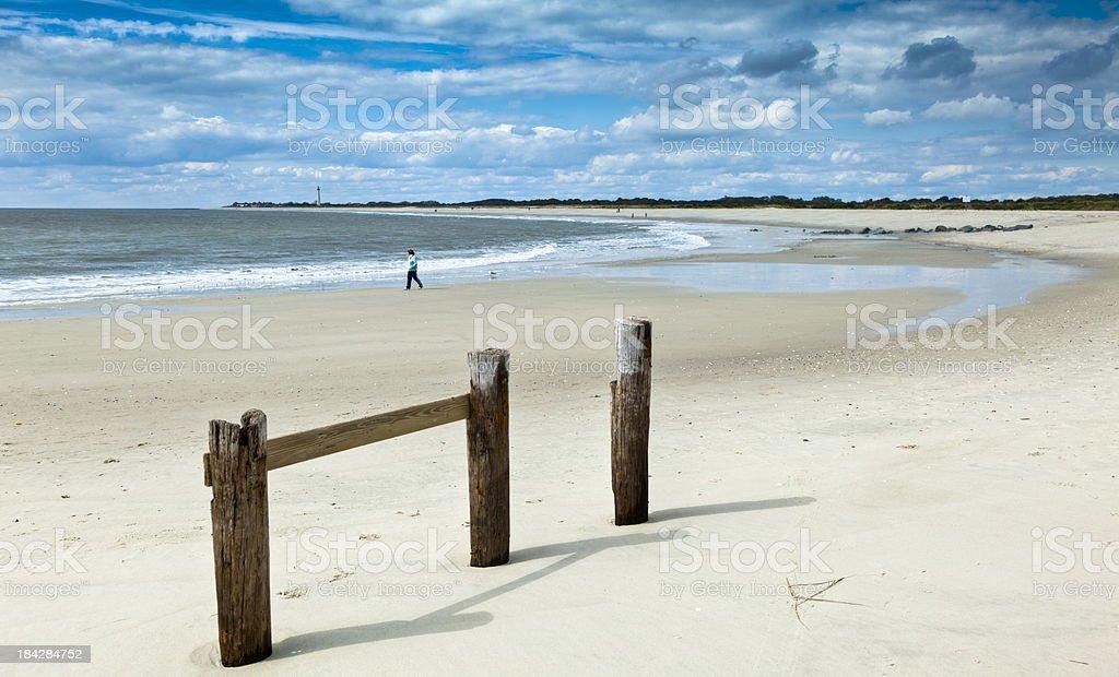 Ocean Surf Rolling onto Pristine White Beach stock photo