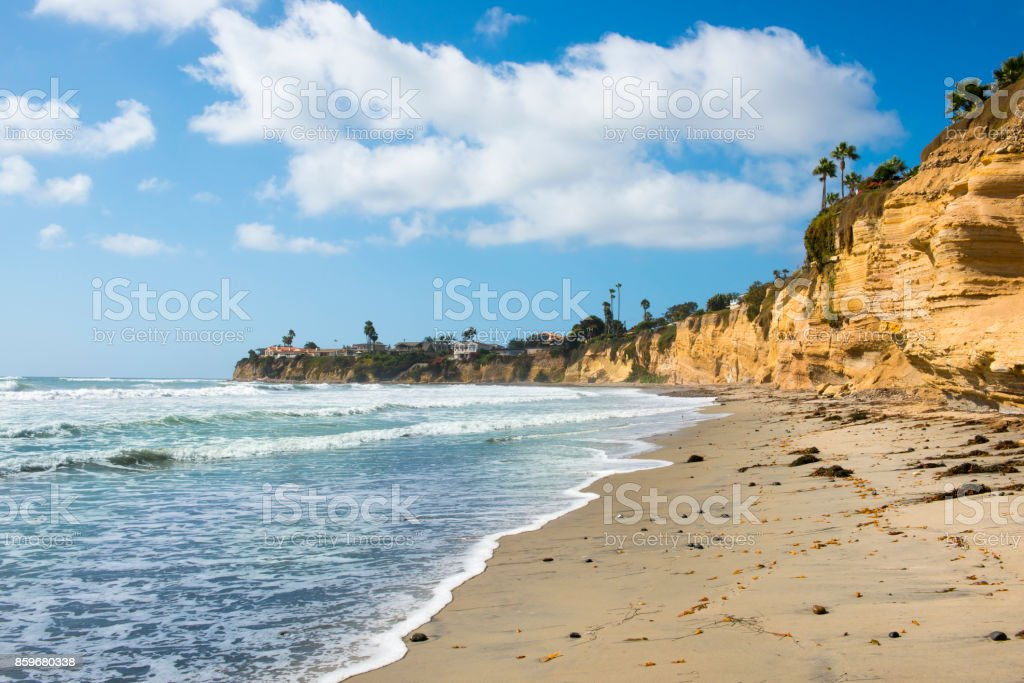Ocean surf. Sea white foam on sand beach. California coast near San Diego. stock photo