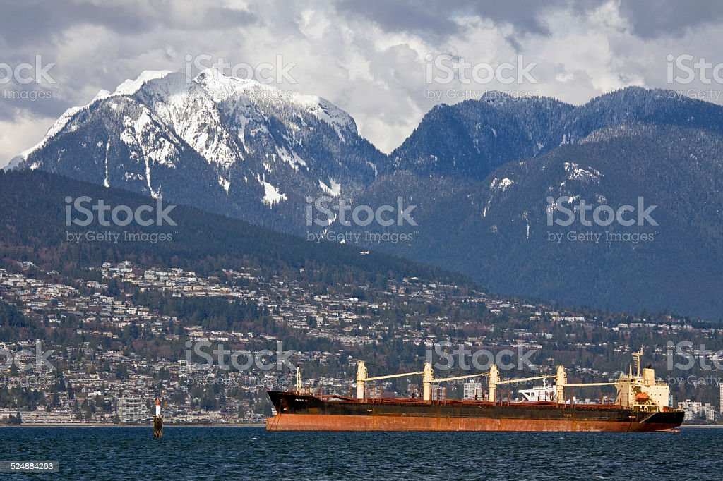 Ocean tanker in Burrard Inlet with North Shore Mountains behind stock photo