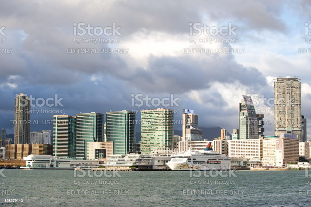 Ocean terminal and Victoria harbour at Tsim sha tsui, kowloon at sunset. stock photo