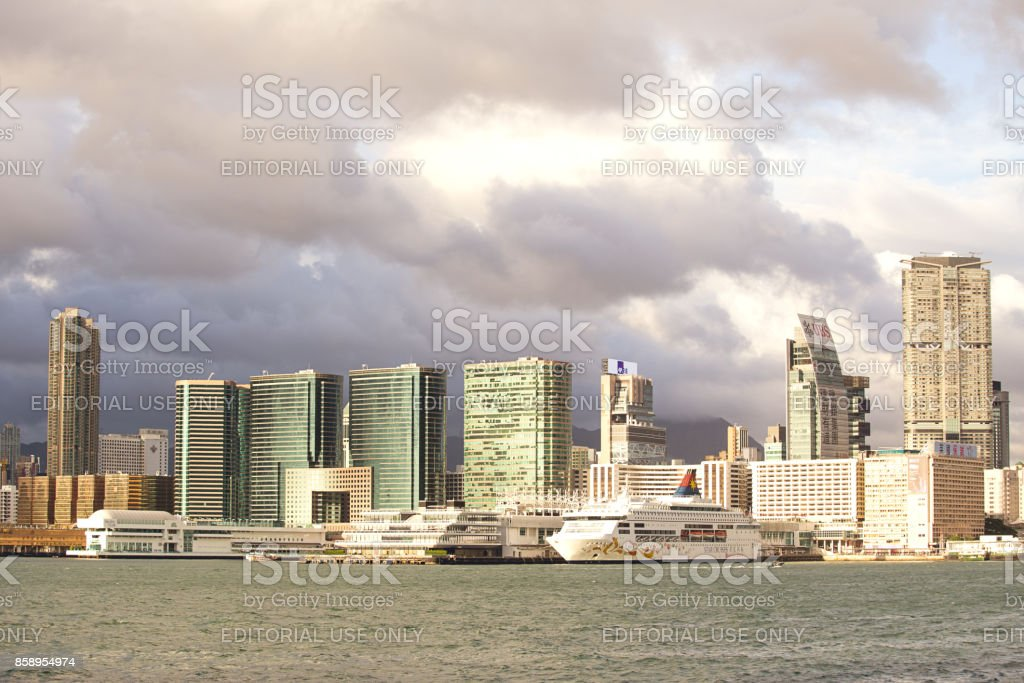 Ocean terminal and Victoria harbour at Tsim sha tsui, kowloon at sunset stock photo