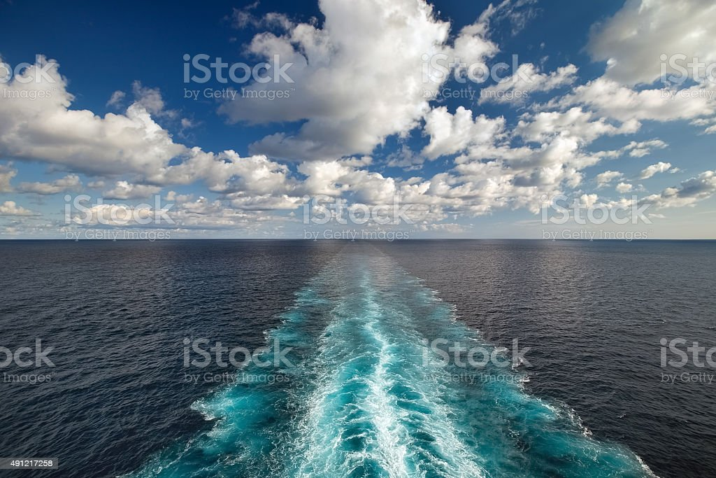 Ocean view from a ship with wake trace stock photo