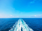 Ocean wake from cruise ship, on bright summer day.