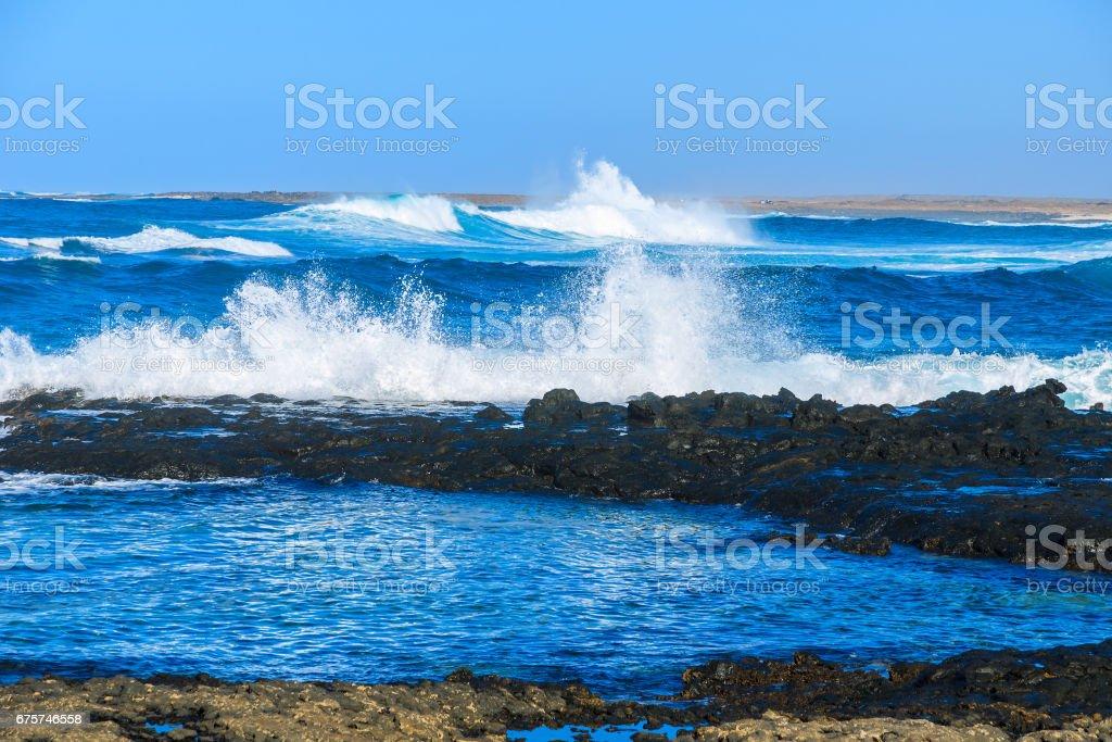 Ocean wave and rocks on coast of Fuerteventura island, Canary Islands, Spain stock photo