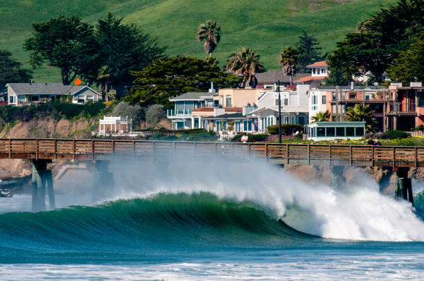ocean wave at pier - central coast california stock photos and pictures
