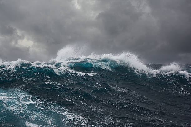 ocean wave during storm stock photo