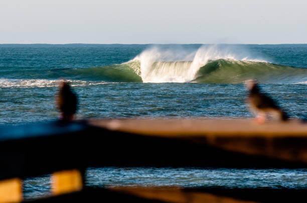 Ocean Wave off Pier stock photo